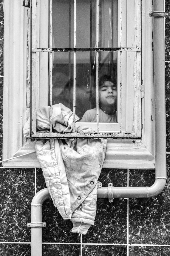 The Turkey Series - A Syrian girl in a window in Al Fatih, Istanbul. Photo by photographer Martin Thaulow. Open Edition (seen without the white frame around the image). Buy high quality print.