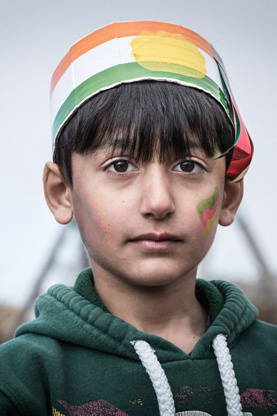 Portrait of a Kurdish boy celebrating Newroz. Photo by photographer Martin Thaulow. Open Edition (seen without the white frame around the image). Buy high quality print.