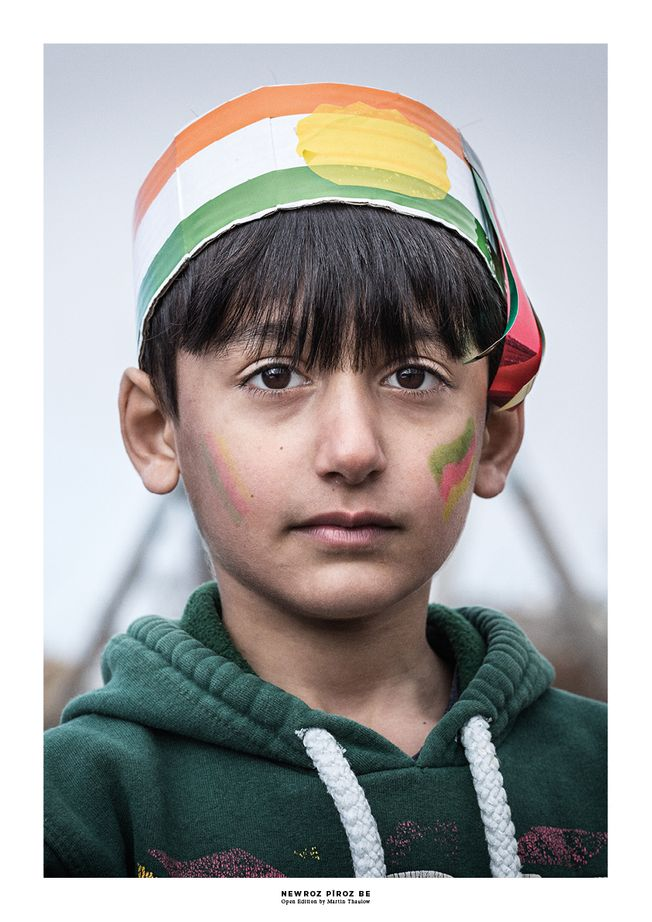 Portrait of a Kurdish boy celebrating Newroz. Photo by photographer Martin Thaulow. Open Edition (seen with the white frame around the image as it is sold). Buy high quality print.
