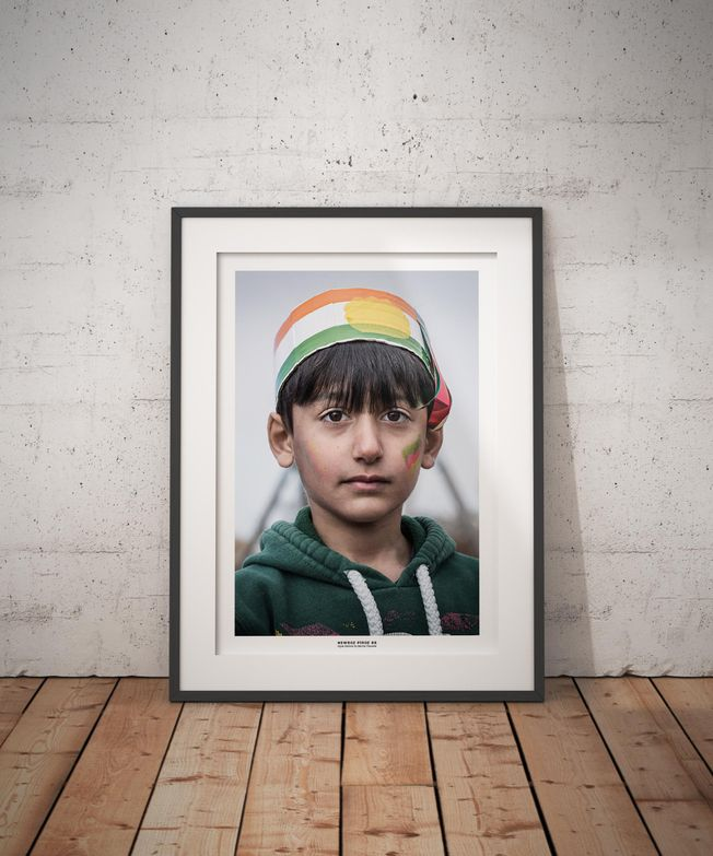 Portrait of a Kurdish boy celebrating Newroz. Photo by photographer Martin Thaulow. Open Edition (seen in a frame in an environment. The frame is not part of sale). Buy high quality print.